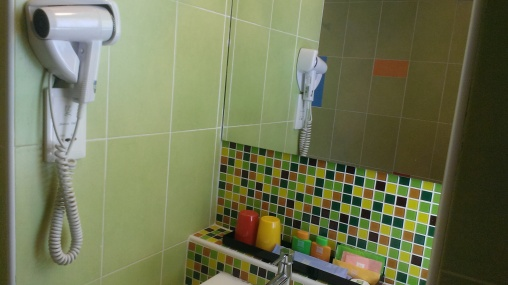Attached hairdryer and bathroom amenities