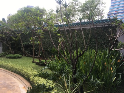 Outdoor gardens leading to the fitness centre